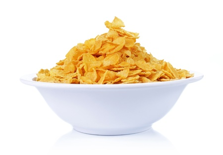 corn flakes: a bowl of corn flakes isolated on white background