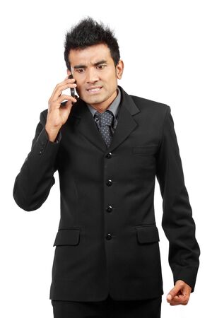 angry businessman on the phone isolated on white background photo