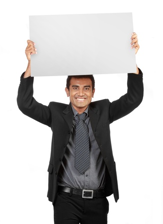 young Businessman holding a blank sign up on his head photo