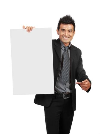 Businessman holding a blank sign, one finger pointing to the sign photo