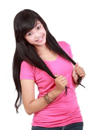 young girl smiling playing with hair Stock Photo - 10338626