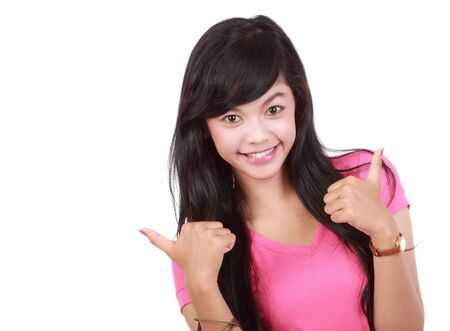Portrait of lovely asian woman wishing good luck over white background Stock Photo - 10338388