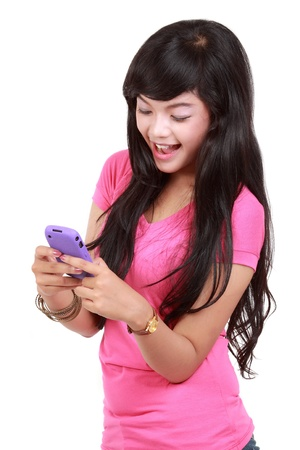 happy teenager texting a message Stock Photo - 10338876