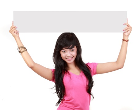 Portrait of a cute young woman holding a long blank board for your text againts white background photo