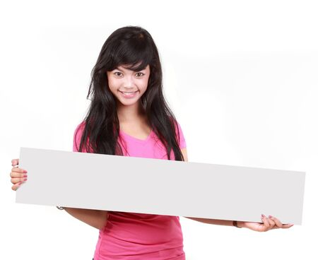 thumbs up sign: Portrait of a cute young woman holding a long blank board for your text againts white background