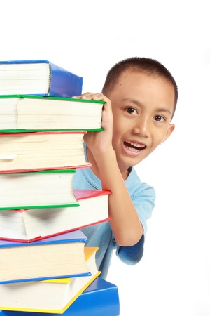 little child hidding behind the pile of book isolated on white background Stock Photo - 10338373