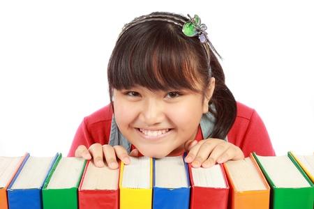 nursery education: Ni�a con pila de libros Foto de archivo