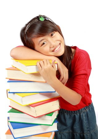 happy Little girl holding pile of books