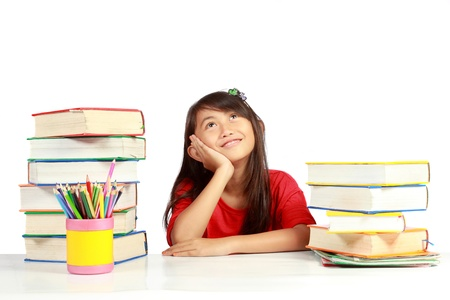 happy schoolgirl with so many books around her Stock Photo - 10338294