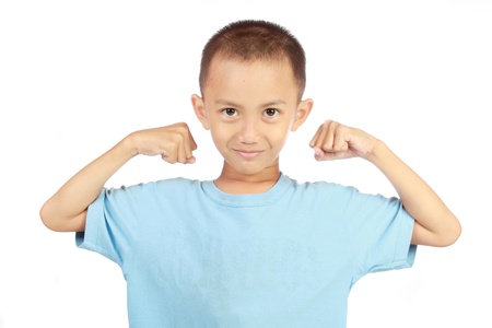 boy muscles: little asian strong boy portrait showing muscles mischief isolated studio on white background Stock Photo