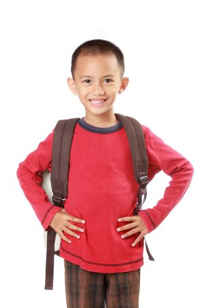 Portrait of boy with backpack smiling against white background photo