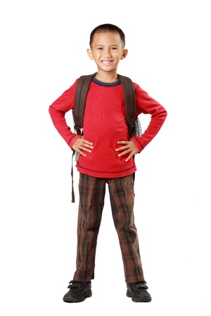 full body portrait of little boy back to school