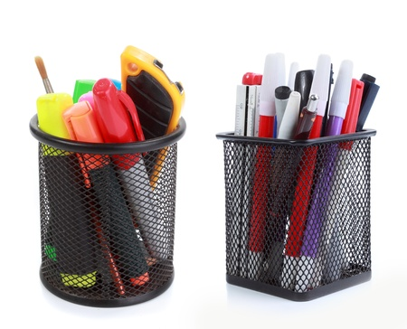 pencil holder: colorful pens in holder isolated on white background