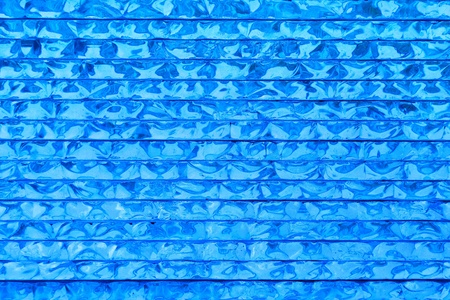 totaled: abstract pattern of blue glass background