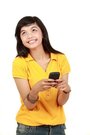 Happy young girl text message on her mobile phone photo