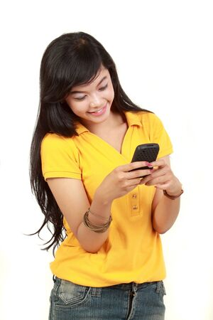 Beautiful smiling young girl holding a cell phone, text a message Stock Photo - 10338871