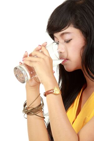 hand water: Beautiful young girl drinks water from glass. isolated on white Stock Photo