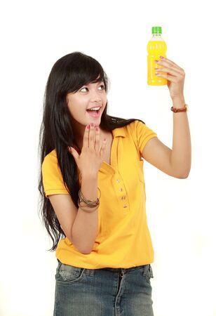 young women only: Teenage girl happy while holding a bottle of orange juice