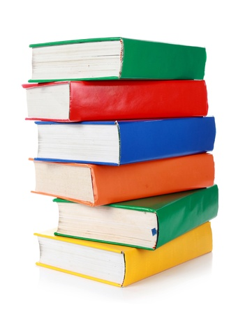 Stack of many colorful books isolated on white background photo