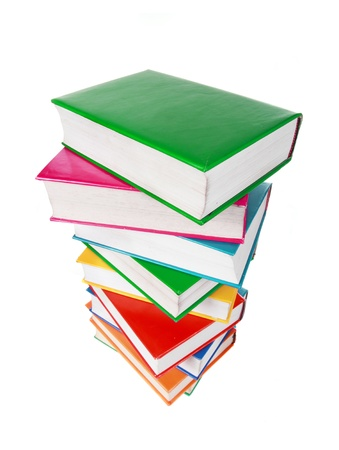 Pile of colorful books isolated on a white background photo