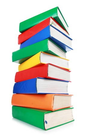 stacked books: Stack of many colorful books isolated on white background Stock Photo