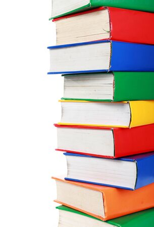 stacked books: a pile of many colorful books with a copy space Stock Photo