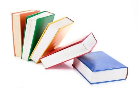 literary: many colorful blank books fall isolated on white background