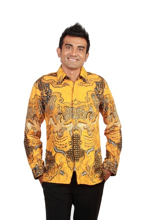 only mid adult men: Portrait of happy smiling man wearing batik, isolated on white background Stock Photo