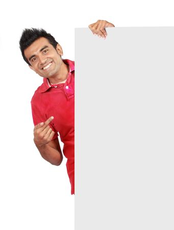 young add: man in nice red shirt smiling holding a big blank card