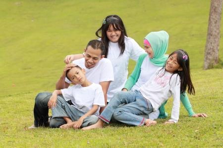asian man smiling: happy family having fun outdoor