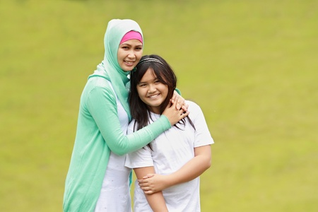 moslem: beautiful young mother and her daughter having fun Stock Photo