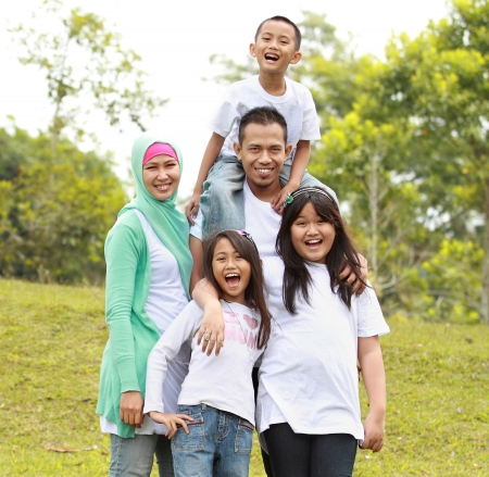 happy asian family: Portrait of Happy Family In Park