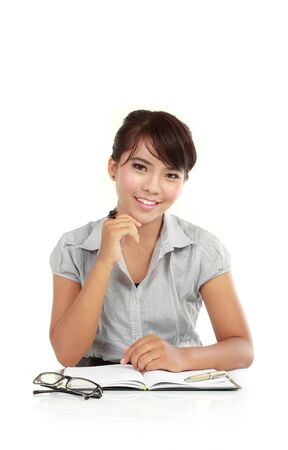 clarify: business woman at her desk waiting for client