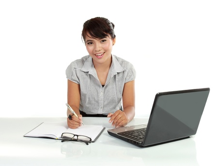 outwork: young business woman working with laptop. isolated over white background