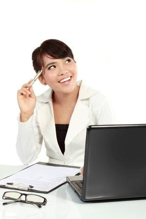 Casual business woman in office working with laptop on the table. got an idea photo