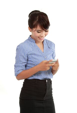 Portrait of happy business woman text messaging photo