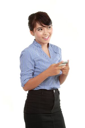 Portrait of happy business woman text messaging on mobile phone over white background photo