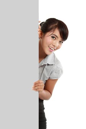 Happy young business woman showing blank signboard, isolated on white background photo