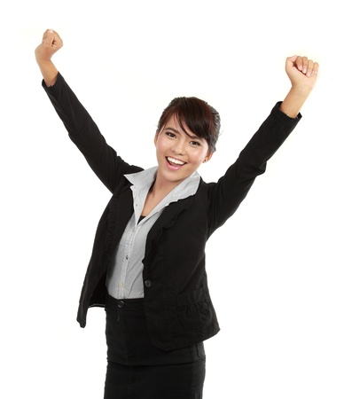 victory stand: Portrait of happy young business woman celebrating success