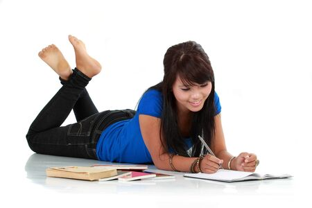 Young smiling asian woman with book and pen isolated Stock Photo - 10761854