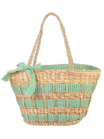 beautiful green wicker bag in isolated background photo