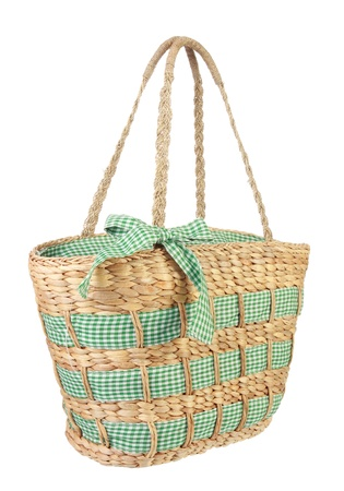 hand woven: Eco friendly wicker shopping bag made of natural material in isolated background Stock Photo