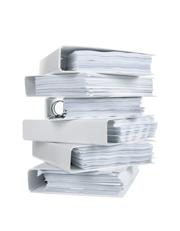 Stack of office ring binders in isolatad white photo