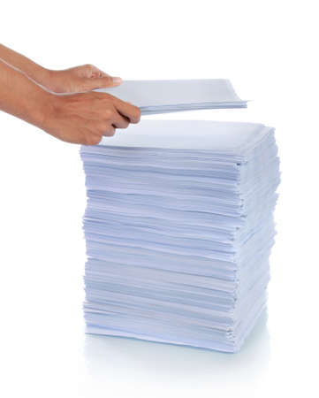 grabbing hand: hand put paper on stack of paper. with isolated background