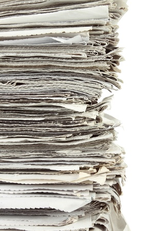 pile up: Stack of newspaper on white background close up