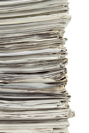 informed: stack of used papers for recycling in isolated background