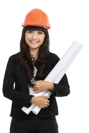 Young woman architect with orange hardhat and project with isolated background Stock Photo - 11093090