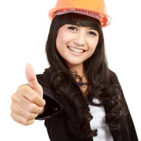 young architect with yellow helmet holding thumb up on white backgorund Stock Photo - 11093050