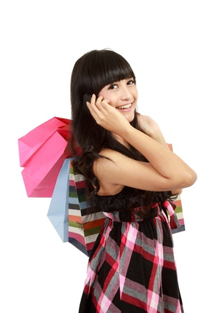 young woman shopping and calling her friends in isolated background Stock Photo - 11093120