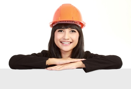 Female engineer with a banner isolated over a white background Stock Photo - 11092948